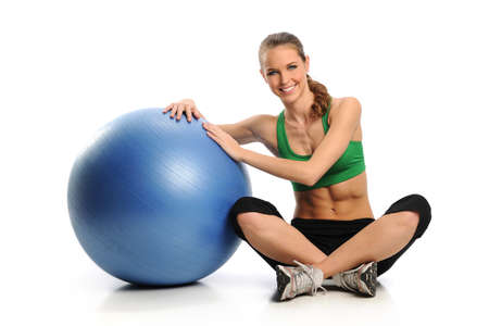 Young Woman workin gout with Swiss Ball isolated on a white background photo