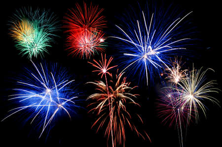 Fireworks of various colore bustring against a black  background photo