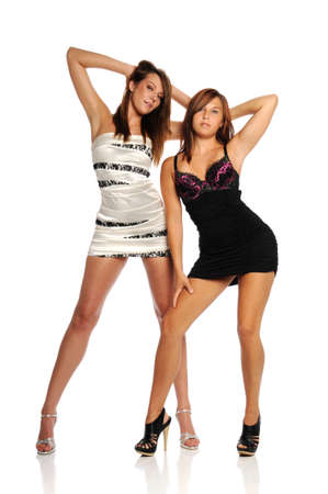 mini jupe: Belles jeunes femmes portant des robes courtes isolé sur un fond blanc Banque d'images