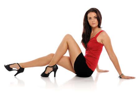 short skirt: Young brunette woman wearing a short skirt isolated on a white background
