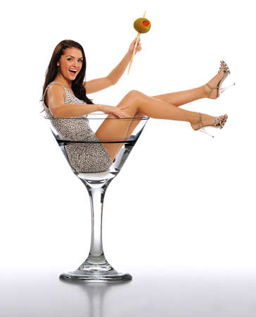 Young Brunette Woman in a Martini Glass isolated on a white background photo