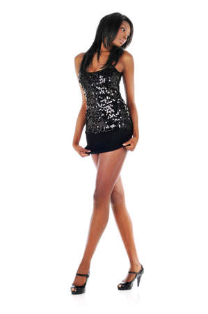 seductive women: Young African American Woman Wearing a short dress  isolated on a white background Stock Photo