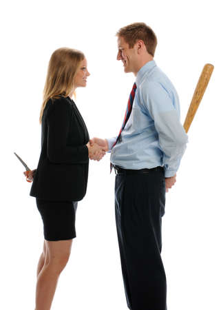 Young Man and Woman shaking hands and hiding weapons isolated on a white backgroung Foto de archivo