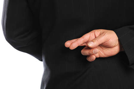 crossing fingers: Businessman Crossing Fingers Behind His Back isolated on a white background Stock Photo