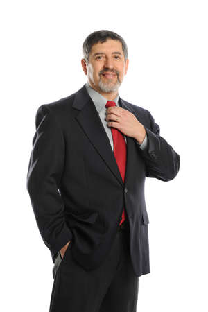 latin man: Portrait of businessman holding his tie isolated on a white background