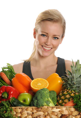 womna: Young Womna holdind a basket of fruits and vegetables on a white background