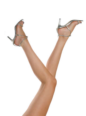 long sexy legs: Long sexy legs wearing high heels isolated on a white
