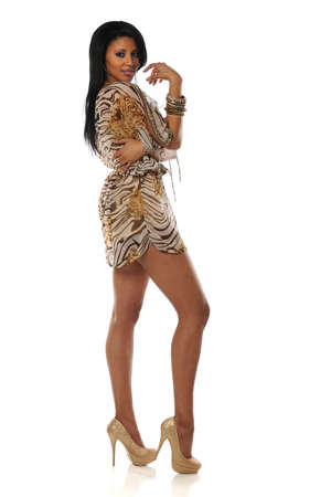 Beautiful African American Woman wearing a short dress and high heels photo