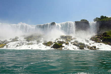 rainbow bridge: Niagara Falls as seen from the river overlooking at the American side Stock Photo