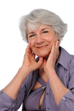 75s: Senior Citizen Lady smiling isolated on a white background Stock Photo