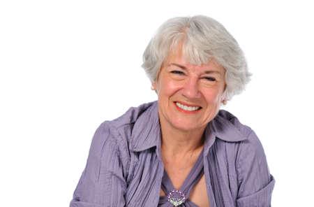 75s: Senior Lady smiling isolated on a white background
