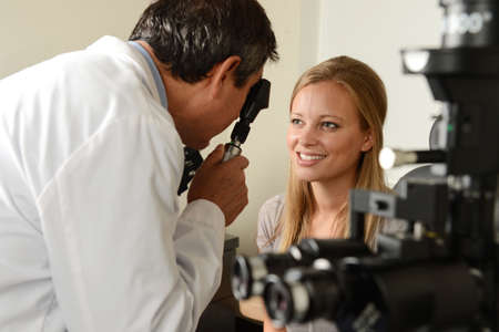 doctor of optometry: Eye Doctor with female patient during an examination at the office