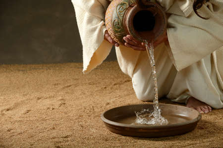 jesus hands: Jesus pouring water from a jug (with copyspace for text)