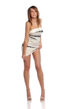 Young Beautiful woman fashion model wearing a short dress and heels