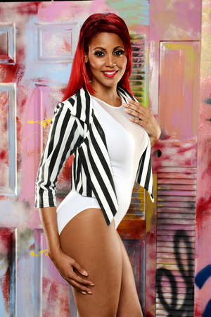 Young Black woman with red hair against a colorful background photo