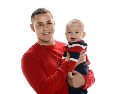Young hispanic father holding his son isolated on a white background Stock Photo