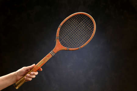 Vintage tennis racket isolated on a neutral background