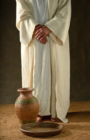 jesuschrist: Jesus standind with his hands crossed and with a jar and bowl