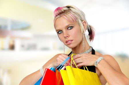 Gorgeous girl with shopping bags inside a mall Stock Photo