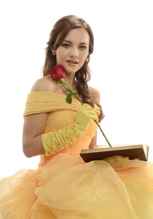 Young Woman wearing a princess costume holding a book and rose Stok Fotoğraf