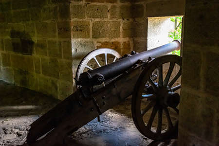 Cannon positioned to defend against enemy attack during medieval battles.