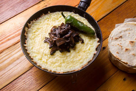 Traditional mexican melted cheese with mushroom