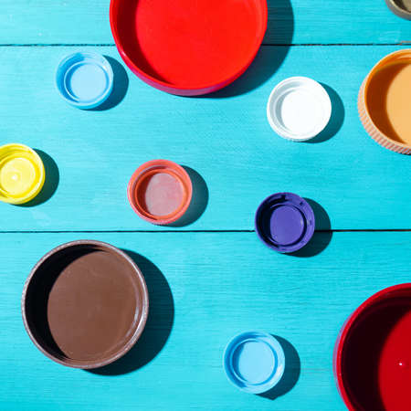 Set of colorful bottle plastic caps and lids on blue background