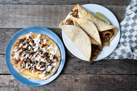 """Traditional mexican tacos known as """"arabes"""" style on wooden background"""