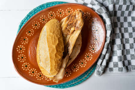 Traditional mexican mole tamal sandwich also called