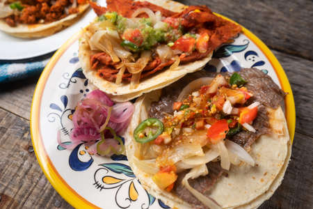 Traditional mexican tacos on wooden background