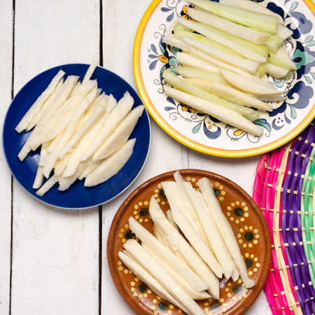 Traditional mexican jicama and cucumber cutted on white background