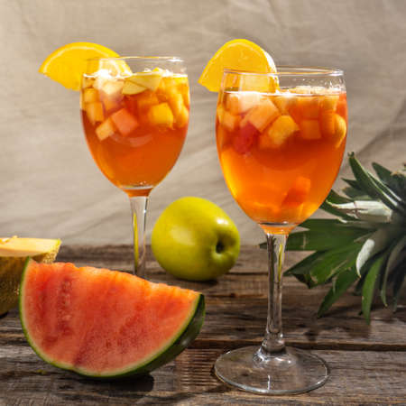 Cold sangria cocktail with wine and fresh fruit
