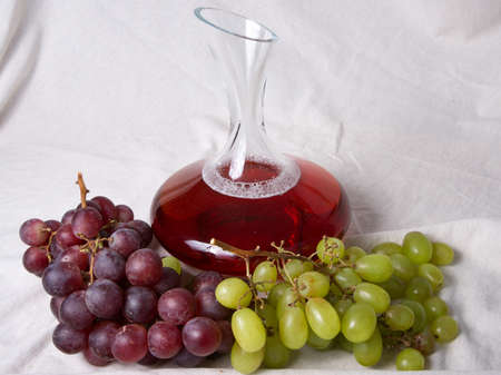 vinery: Old Decanter of Red Wine with Grapes