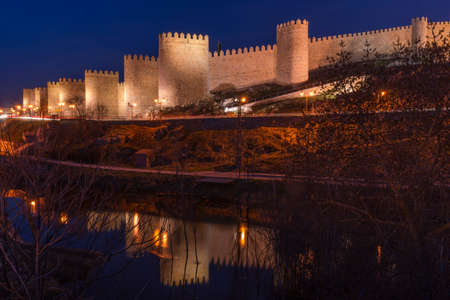 crenellated: Walls of Avila  Spain  With its Reflection in the River Adaja Stock Photo