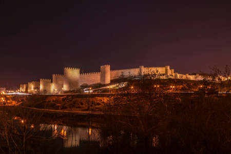 Walls of Avila (Spain) With its Reflection in the River Adaja photo
