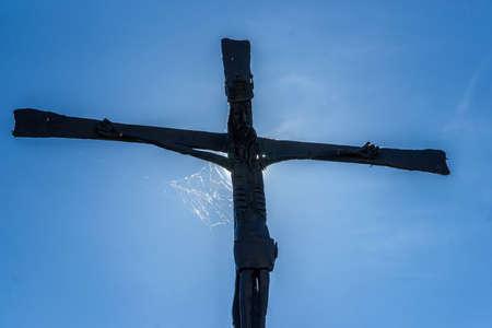 way of st james: Old Metallic Crucifix wihth a Spiderweb in Obanos, Navarre, Spain. St. James Way.