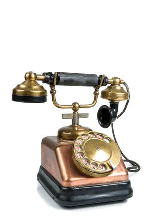Oude telefoon geïsoleerd op wit Stockfoto