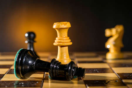 withe: Some Chess Wooden Pieces on Their Board