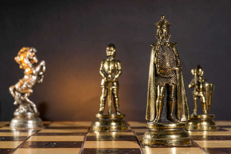withe: Some Chess Metallic Pieces on Their Board Stock Photo