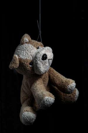 metaphoric: Stuffed Dog Committed Suicide. Metaphoric Photo. Stock Photo