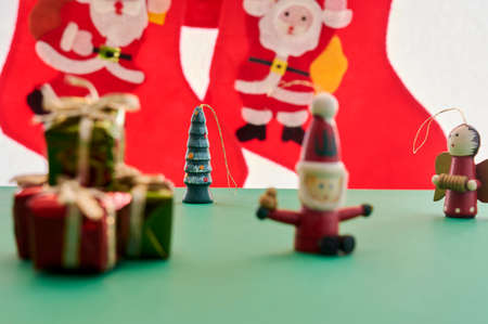 Christmas Decoration, some different Christmas ornaments, on a green and black color background, in new normality