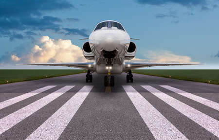 Front view of a private jet on the runway