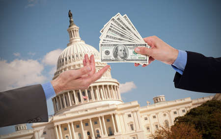 politic: Giving a bribe, hands of businessmen or politicians