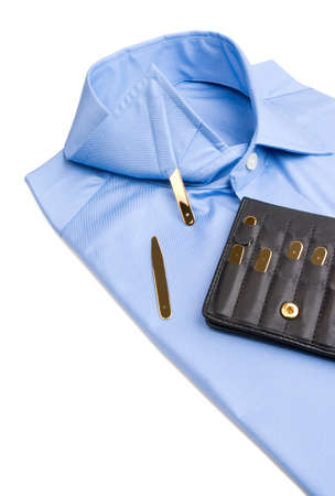 stays: Folded shirt with gold collar stays