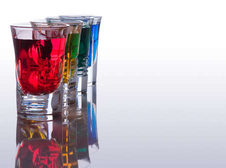 shooter drink: Beautiful and colorful shot glasses back lit