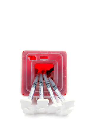 Sharps container and syringes isolated on white