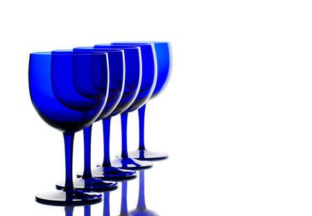 lit: obalt blue glasses back lit on white background Stock Photo
