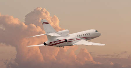 Private jet flying through clouds