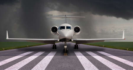 Private jet on the runway with rain the background