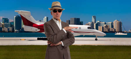 Handsome man standing outside a private jet Reklamní fotografie